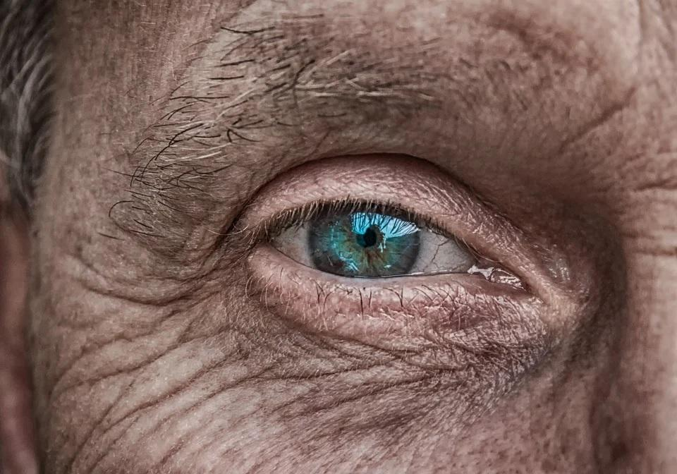 An older man's blue eye.