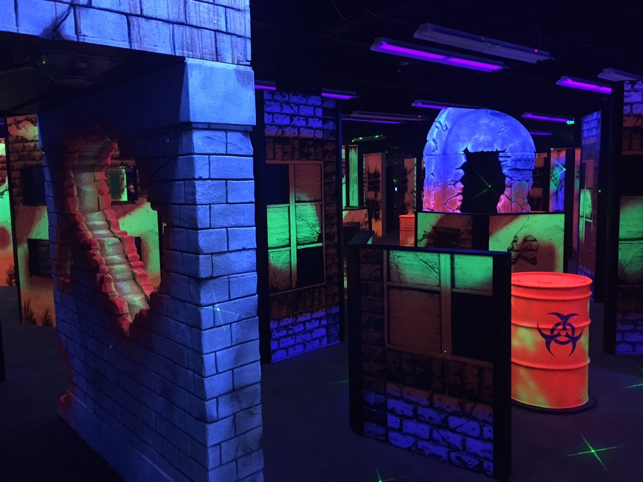 indoor mini golf in the dark with neon lit props