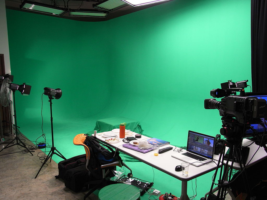A green-screen setup in an office area.