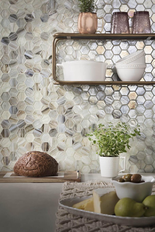 Kitchen backsplash with variegated, iridescent hexagon mosaic tile