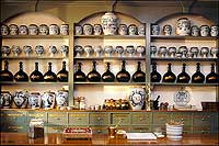 In drawers and in bottles and jars lining the shelves of the apothecary shop are liniments, potions, and pills.