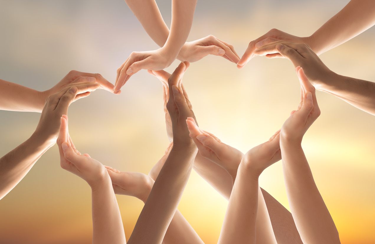 Hands forming a heart to symbolize hope and help for you teenage daughter.
