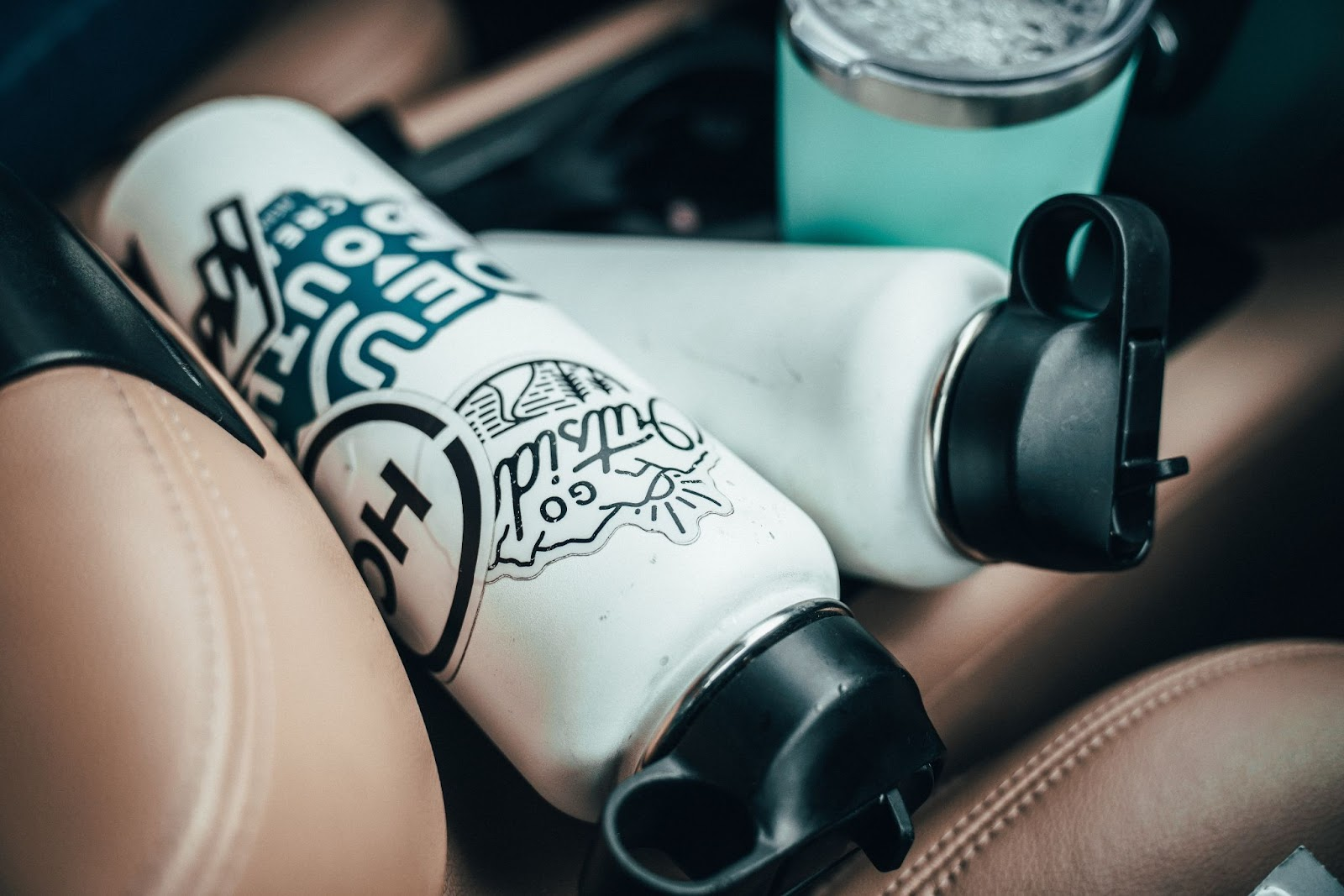 Custom stickers on a hydroflask in a car