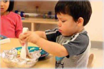 A child serving himself food