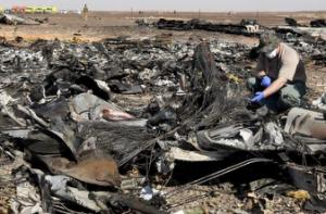 Military investigator from Russia stands near the debris …
