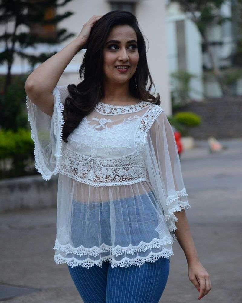 Manjusha in white transparent top and jeans Navel Queens