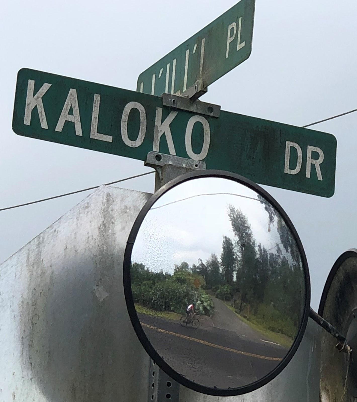 Climbing Kaloko Drive Kailua-Kona by bike.
