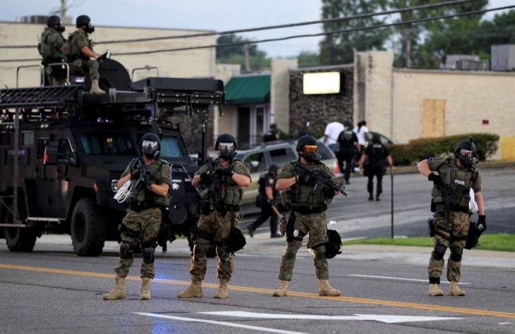 http://www.thenation.com/sites/default/files/user/282985/ferguson_police_riot_gear_812_ap_img.jpg