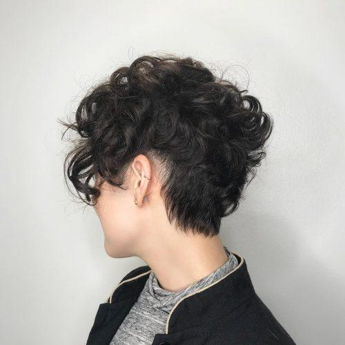 Asymmetrical curly pixie cut