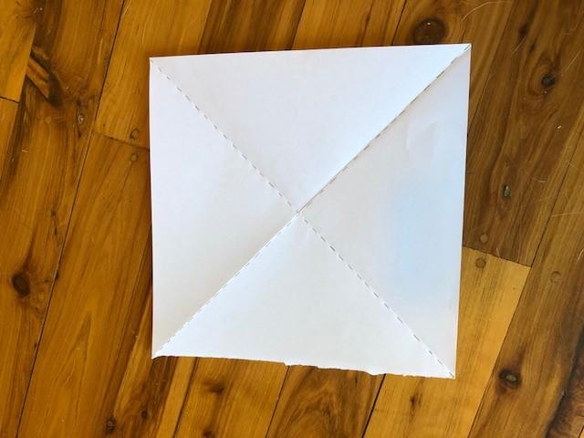 square paper folded along diagonals