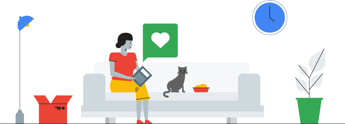 Woman sitting with her cat with a heart above her computer