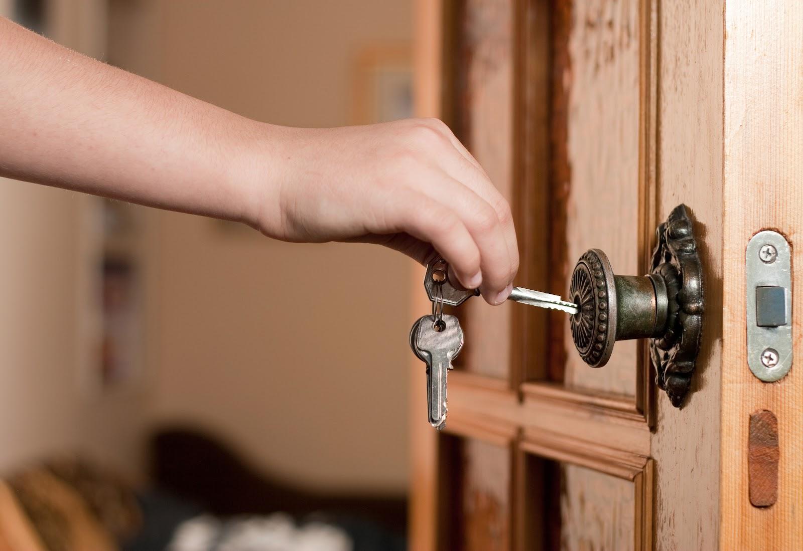 person unlocking a door