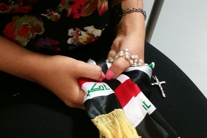 Christina Shabo holds a rosary and a scarf of the Iraqi flag. Credit: Elise Harris/CNA.