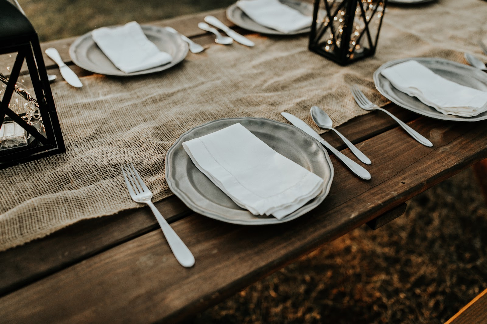 paper wrapped table with place settings, forks and knives