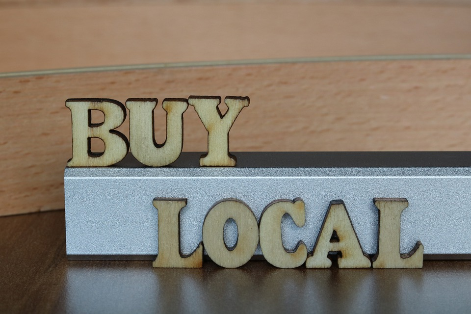 """The words """"""""Buy local"""" engraved from wood"""