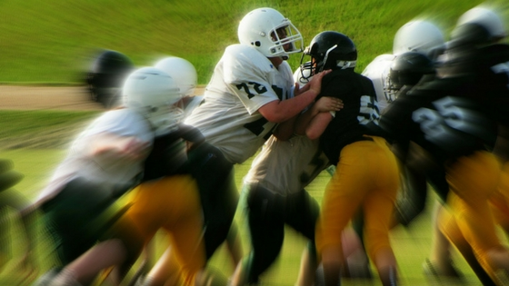 Football players up close tackle