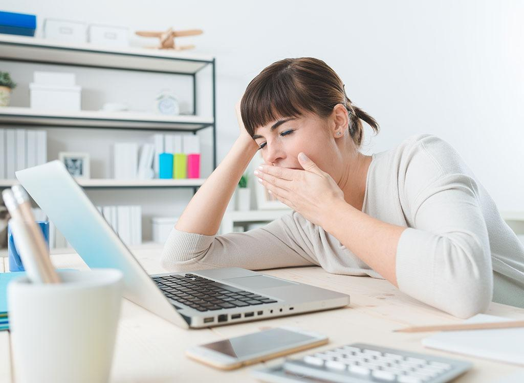 https://www.eatthis.com/wp-content/uploads/media/images/ext/142717047/woman-tired-office.jpg