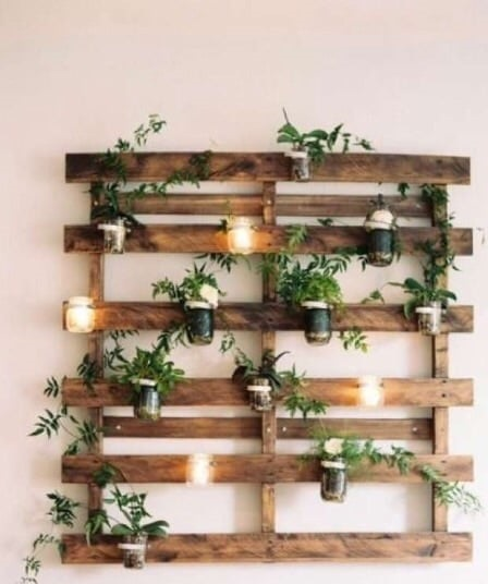 Reuse a dais to hang some plants and candles