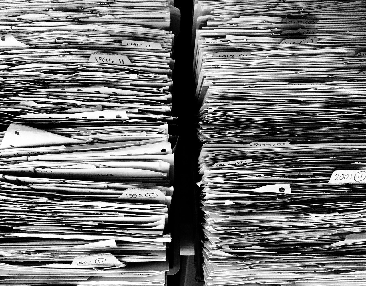 files-paper-office-paperwork-stack-old days and ways of customer data management