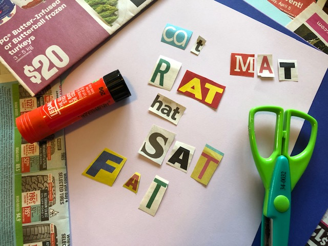 This is a photo of craft supplies and magazine letters cut out to make words.