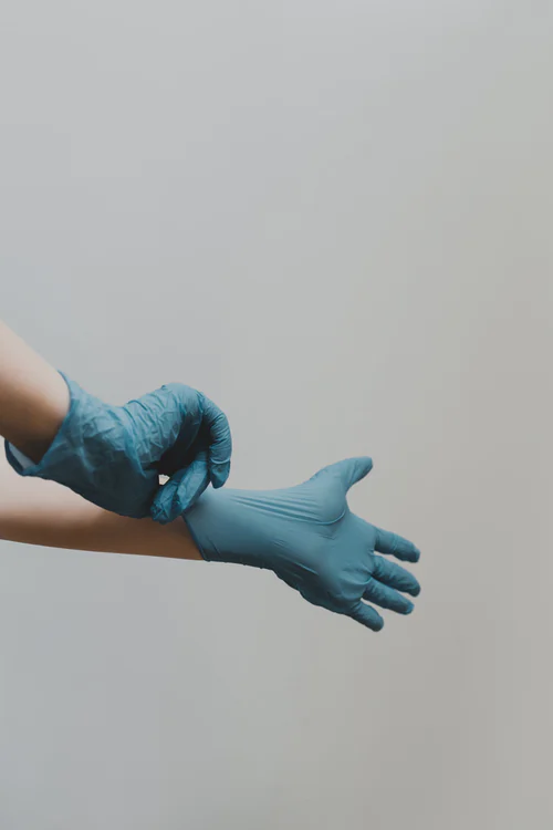 Doctor's gloves to represent surgery, an option to consider if you're desperate to relieve sciatica pain.