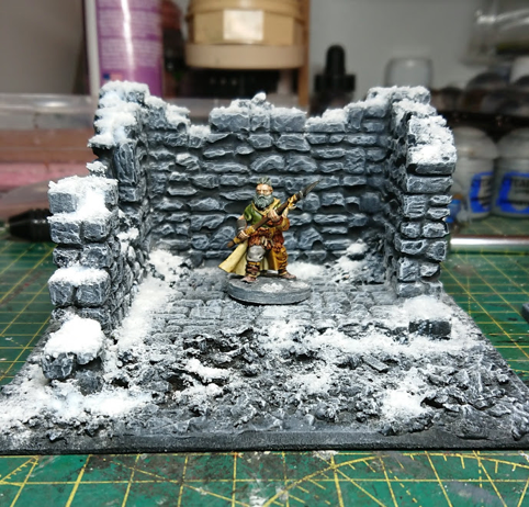 The ruin, with snow effect added and a 28mm model of a barbarian for scale