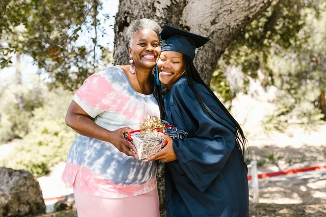 Best graduation gifts; mum and daughter posing for a picture after the graduation ceremony