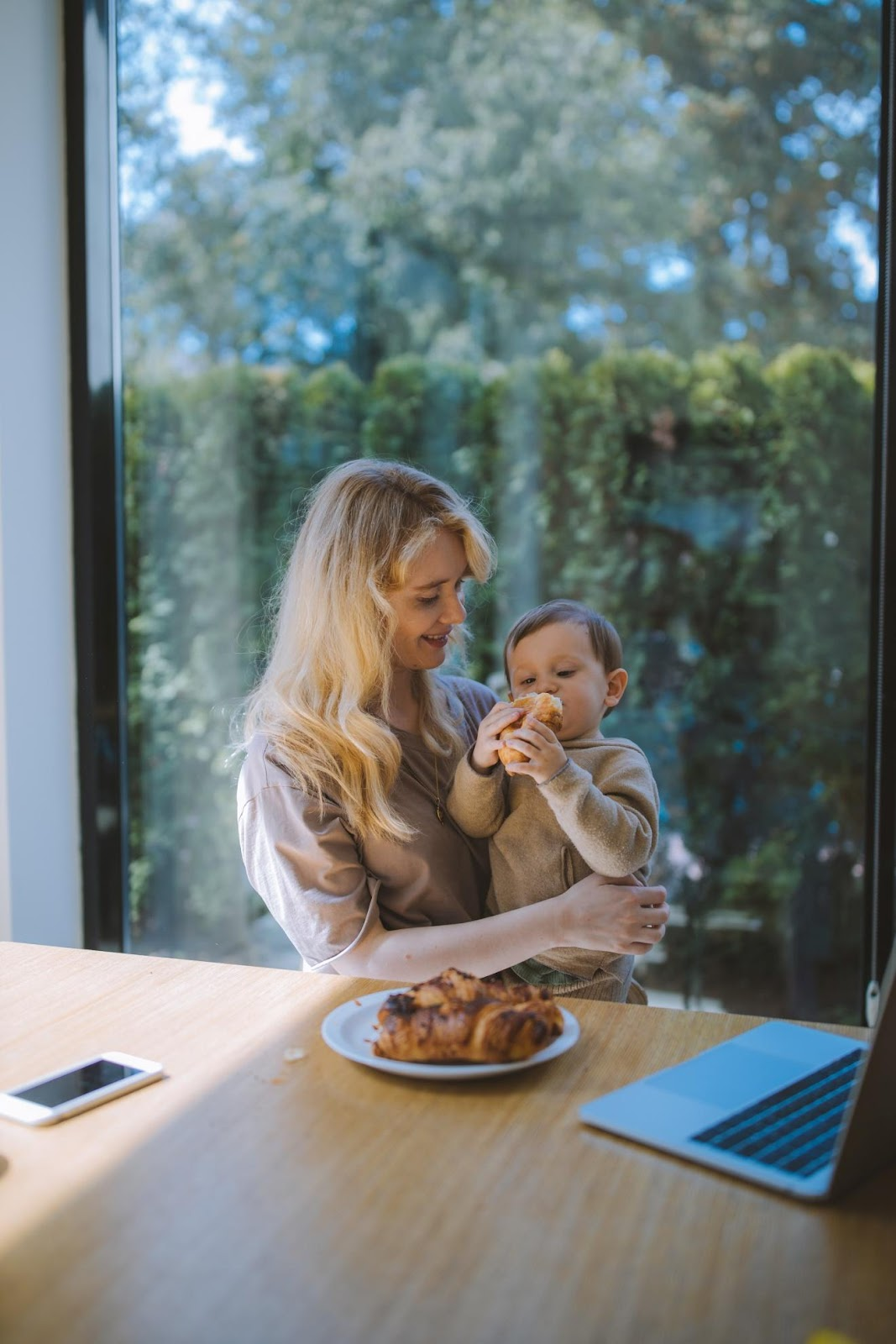 Photo of a baby being introduced to  baby led weaning