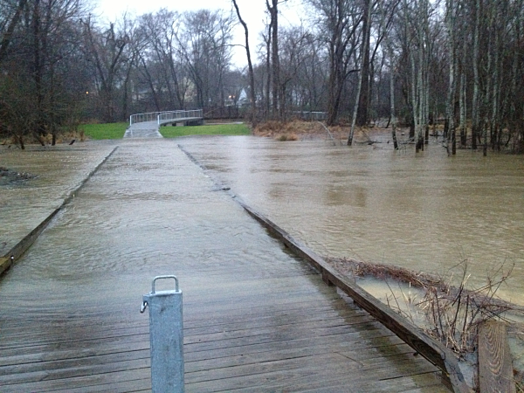 boardwalk experiencing uplift forces from flooding