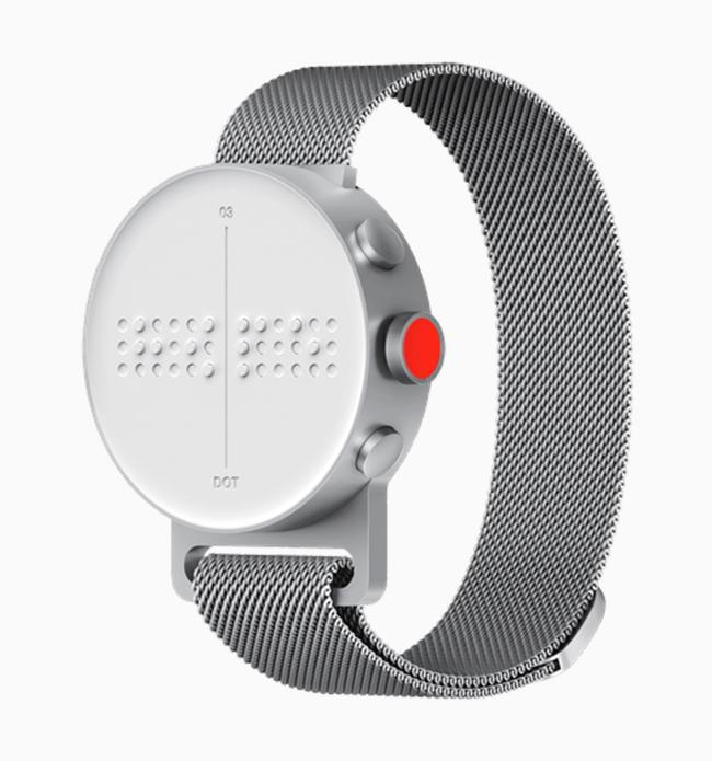 a Dot watch with a metal strap on a white background