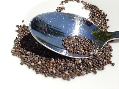A spoon with black risotto