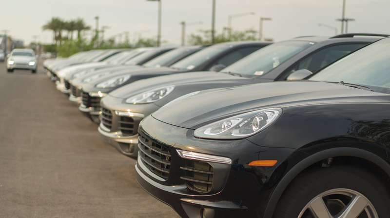 porsche cars at a dealership lined up