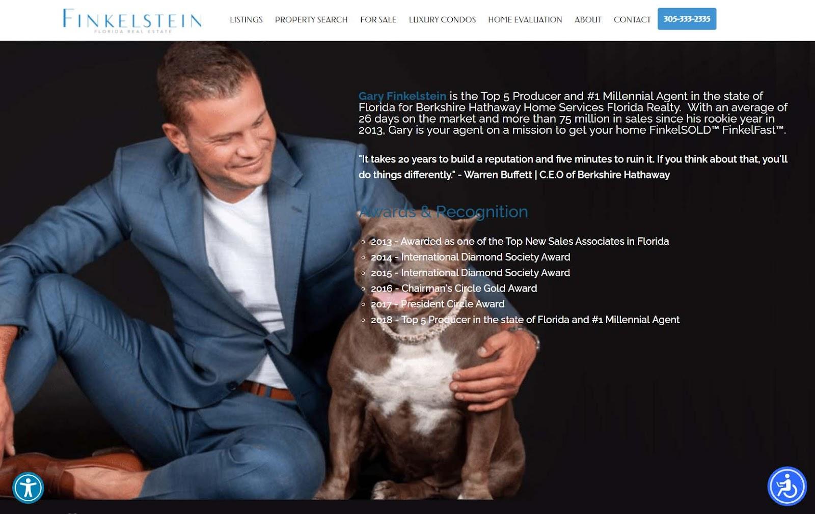 Gary Finkelstein sitting with his arm around his Rottweiler's shoulder.