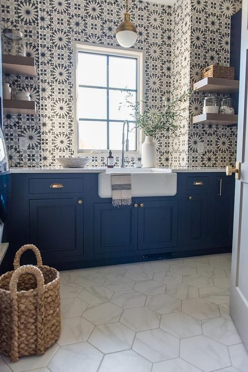 full wall geometric tile blue yellow white apron sink blue cabinets open shelving north atlanta