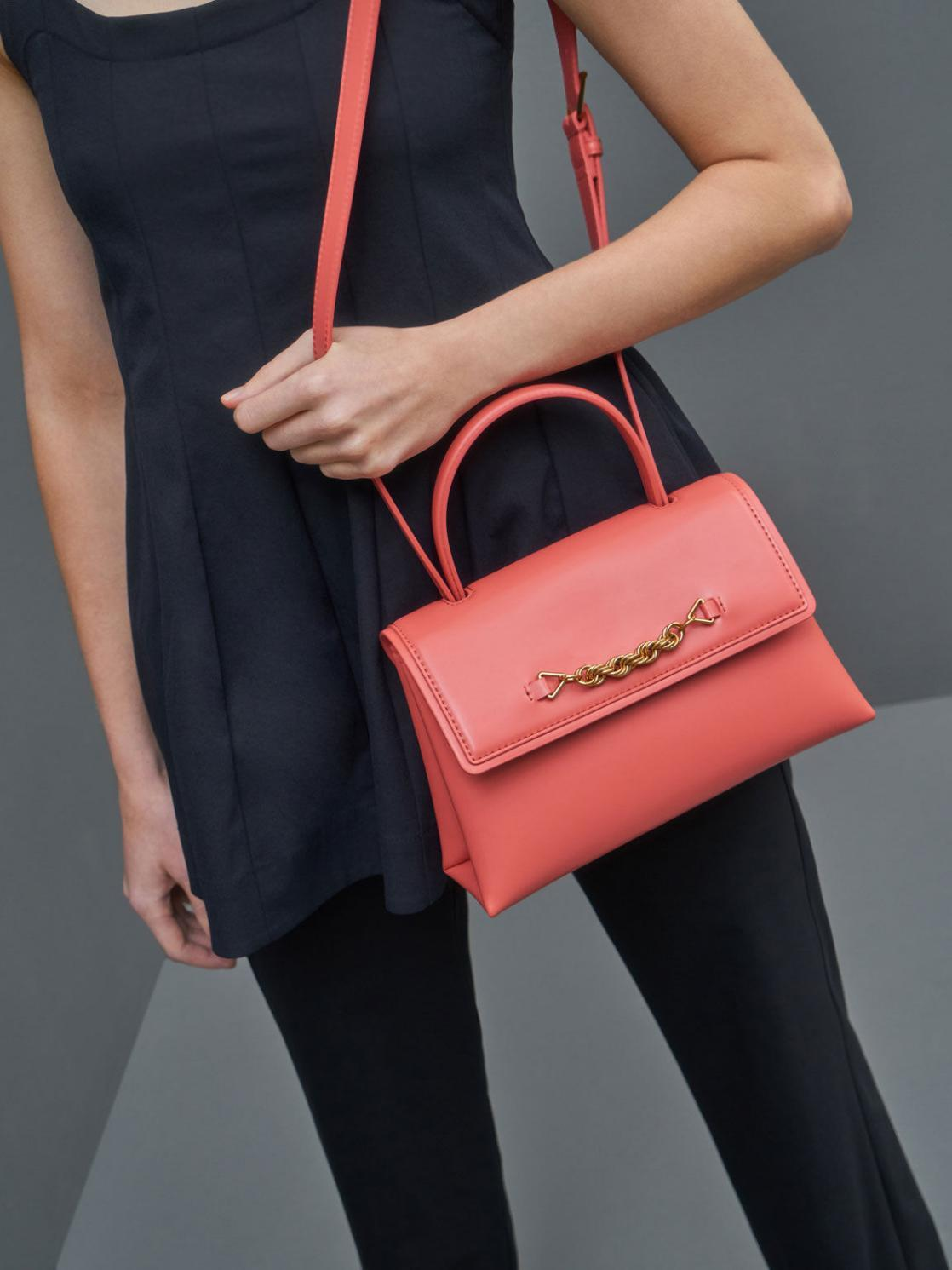 A girl wearing red colour Charles & Keith' handbag