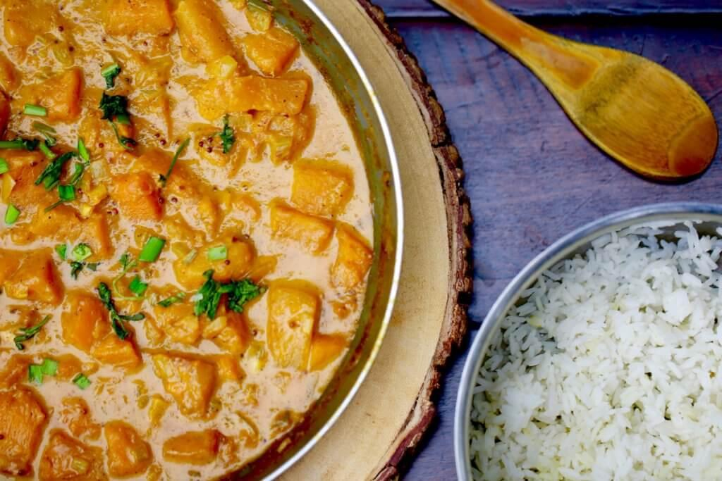 Top View of South Indian Squash Curry with bowl of Rice