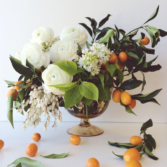 white flowers and oranges