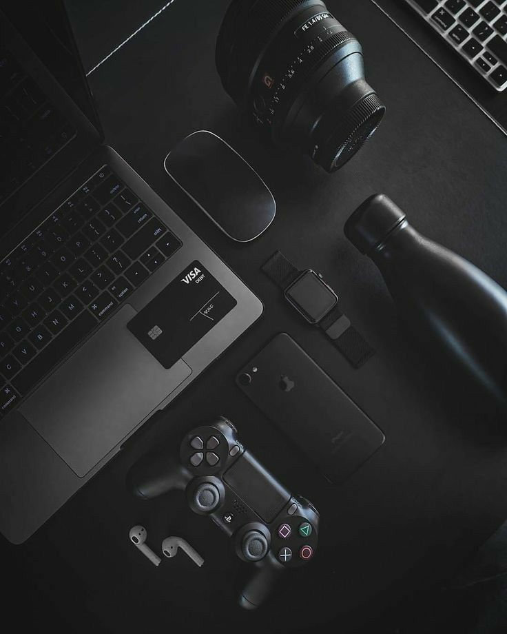 black modern products including laptop, smart watch, phone, camera, gaming controller