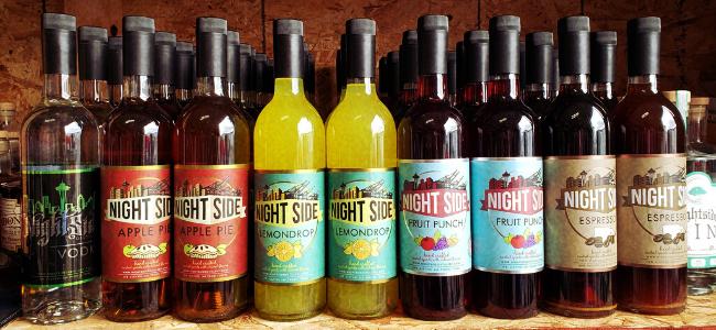 Variety of craft spirit bottles by Nightside Distillery