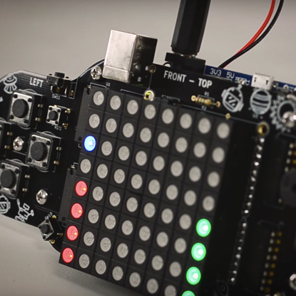 Thimble's RGB Controller is pictured completely assembled with some of the lights on the LED panel lit up.