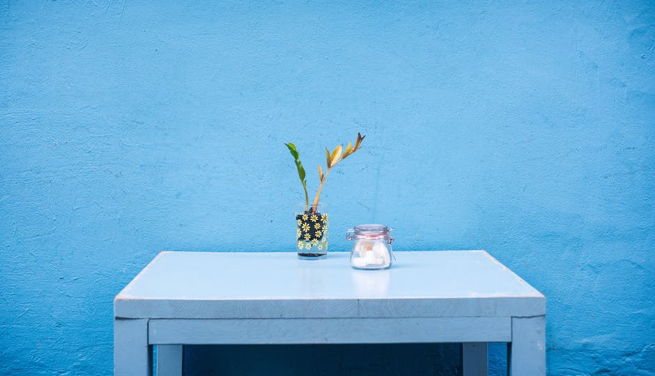 Clear Glass Container on Blue Wooden Table