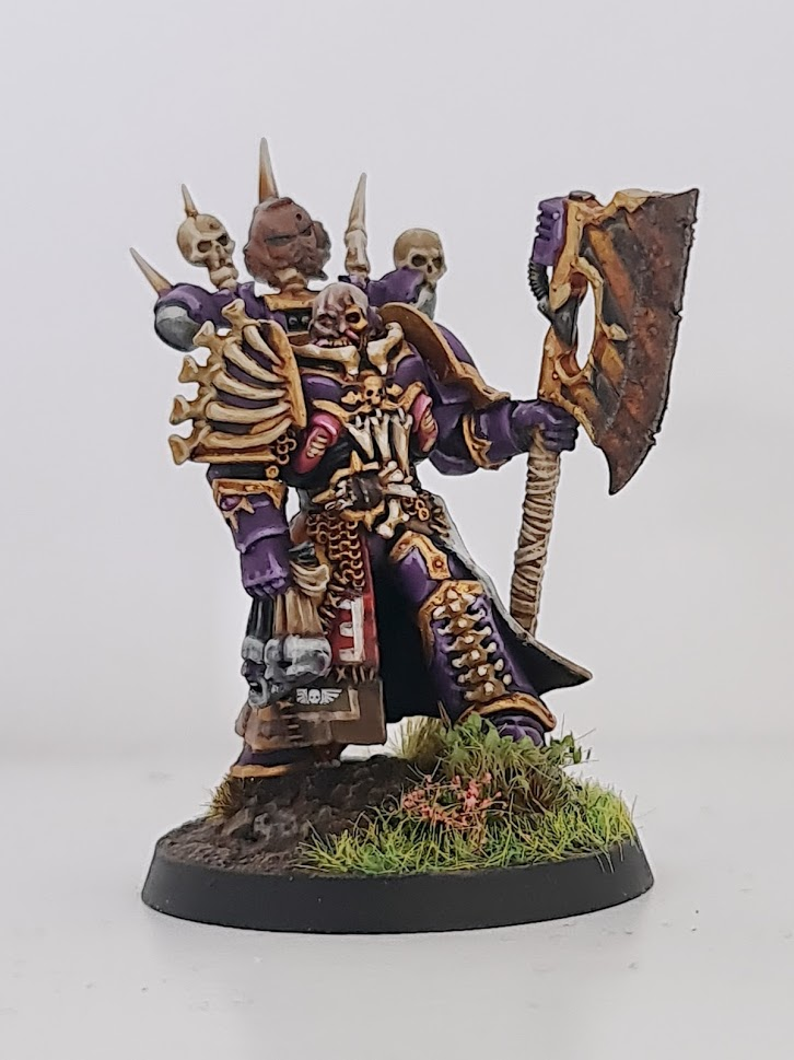 Model Master Of Executions, wearing decorated armour and a cloak made out of banners, and carrying a single massive axe.
