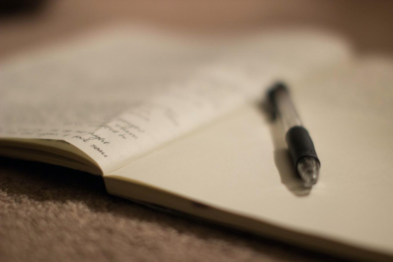 Journalling pen on paper improve mental health covid19 Description automatically generated