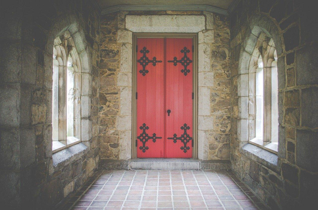 red door with gothic black hardware