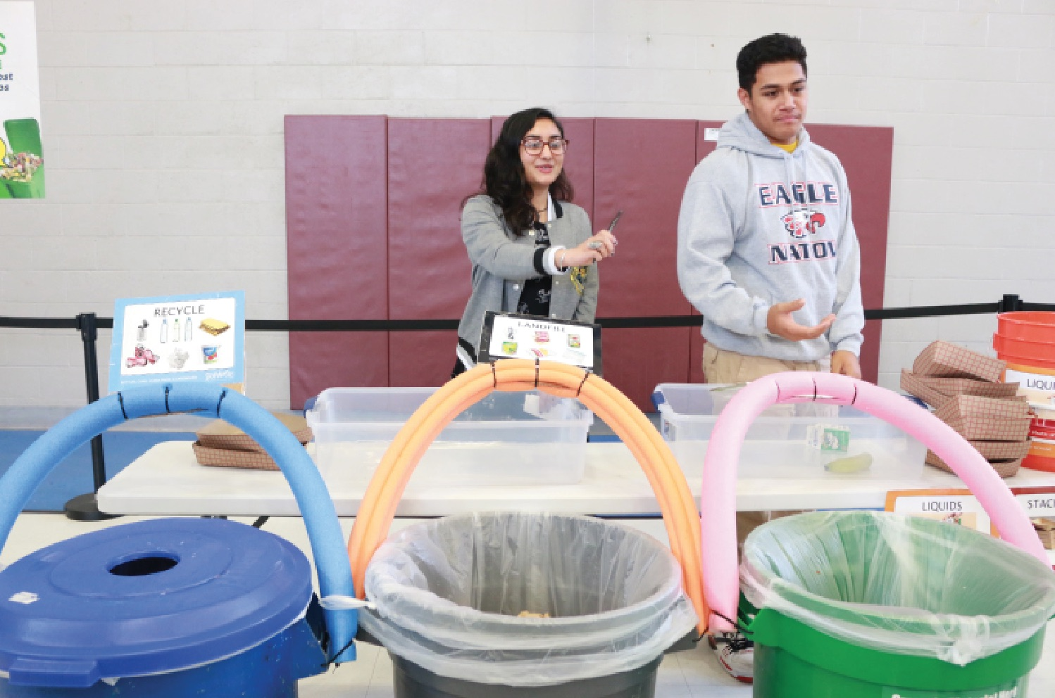 Student volunteer Reha Jandu serves the food share program by directing people to the right bin for the assortment of their leftover food components for nature's benefit.