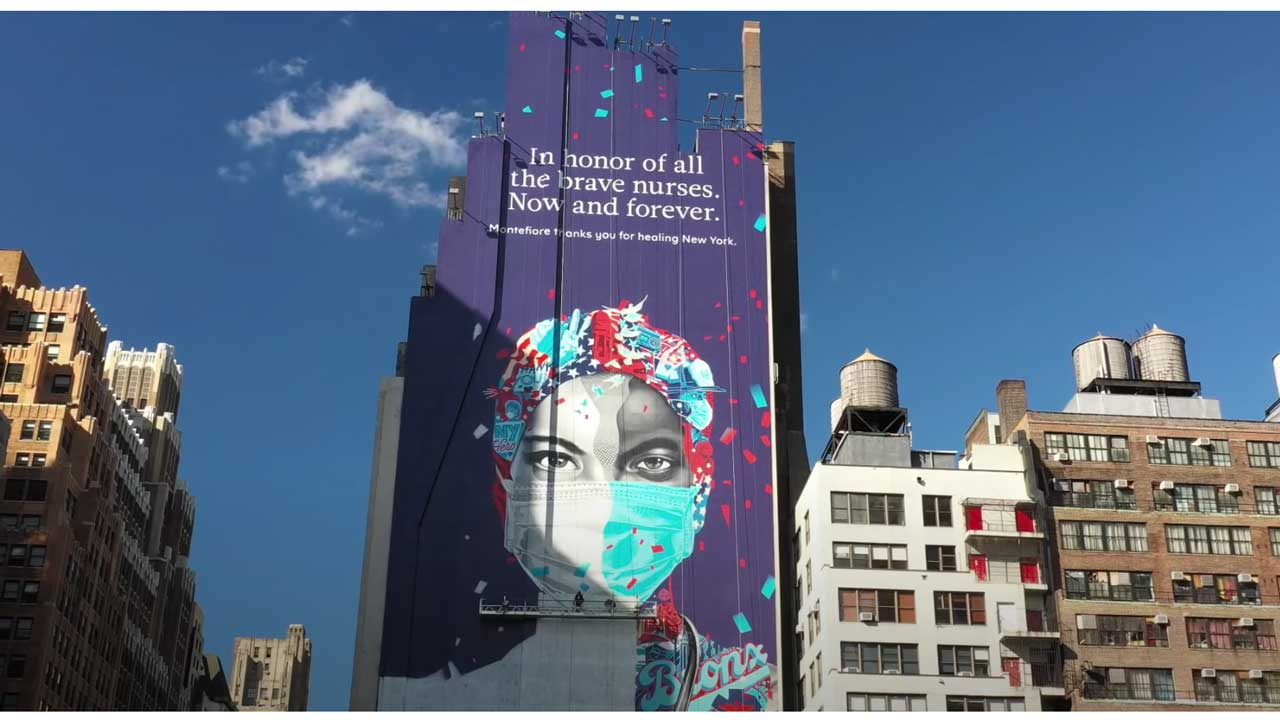 "Wall billboard saying ""In honor of all the brave nurses. Now and forever."" in New York"