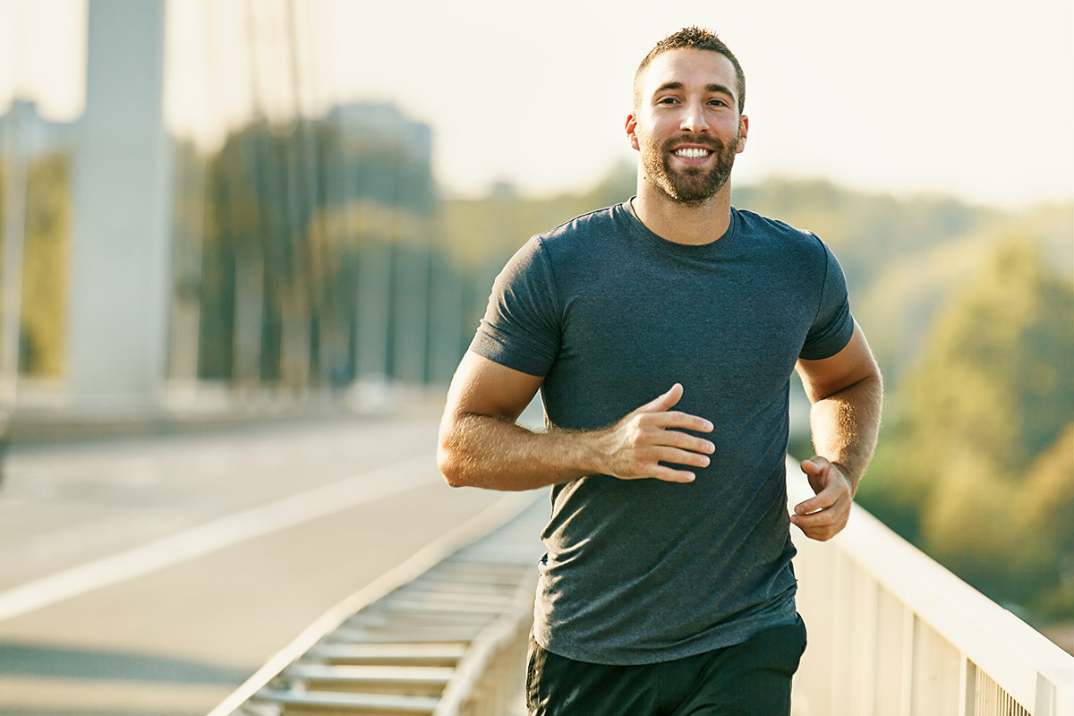 Protein facts: Healthy man jogging on a bridge