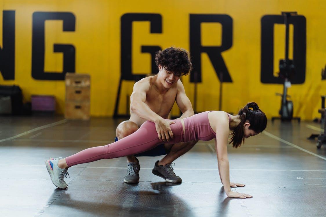 Woman in Pink Leggings Doing Yoga