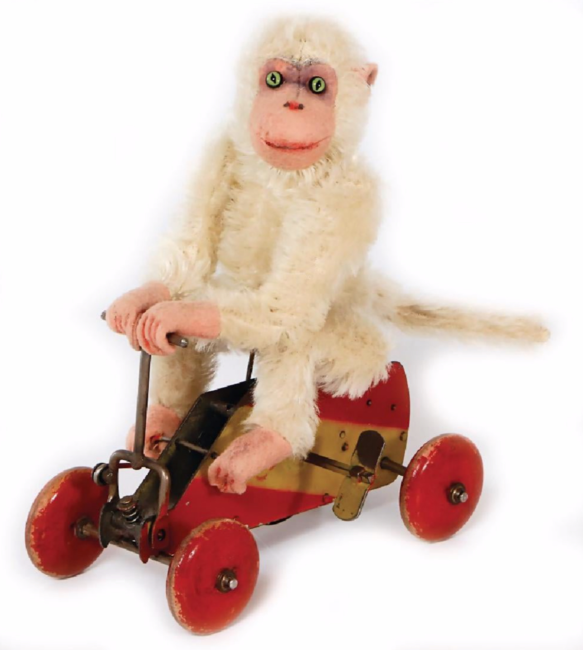 Steiff mechanical chimp on wheels that sold for about $4,000 through Ladenburger Spielzeugauktion GmbH; image from Liveauctioneers.