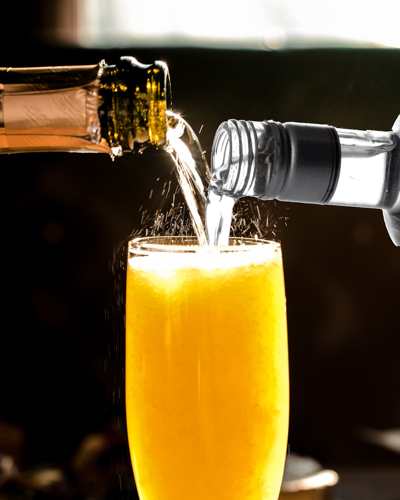 imagine showing a bottle of cava and a bottle of vodka being poured into a flute of orange juice